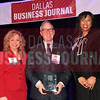 John Torres, Executive vice president, chief legal officer and secretary, Lennox International, (center) receives his Minority Business leader Award, from Tammy Wood, (left), and Sonja McGill, (right) partners with sponsor Bell Nunnally.