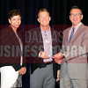 Ernie Cotes, CEO of Chemical Information Dervices accepts the Torch Award for Ethics in the small catagory from presenting sponsors Phylissia Clark, left, and Jay Newman of BBB Serving North Central Texas.