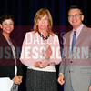 Patti Niles, CEO of Southwest Transplant Alliance accepts the Torch Award for Ethics in the non-profit catagory from presenting sponsors Phylissia Clark, left, and Jay Newman of BBB Serving North Central Texas.