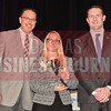 Lauren Leahy of Pizza Hut, LLC, center, is presented with her Women in Business Award from Brian Enzler, Market Executive, BMO Harris Bank, right, and Bill Hethcock of the Dallas Business Journal.