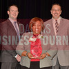 Melody Lenox of Axxess, center, is presented with her Women in Business Award from Brian Enzler, Market Executive, BMO Harris Bank, left, and Bill Hethcock of the Dallas Business Journal.