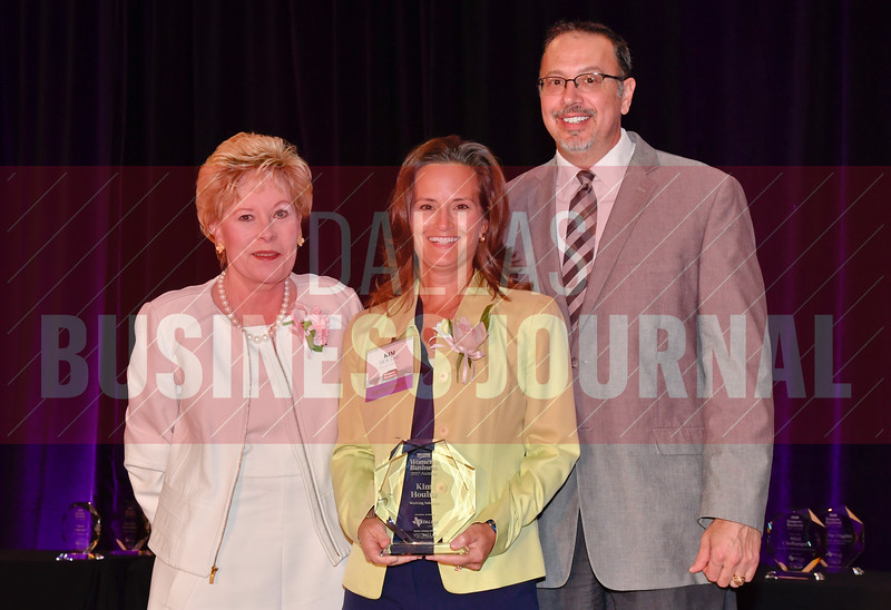 Kim Houln of Working Solutions, center, is presented with her Women in Business Award from Diane McNulty, Associate Dean for External Affairs/Corporate Development, Naveen Jindal School of Management, UT Dallas, left, and Bill Hethcock of the Dallas Business Journal.