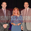 Tracy Skeans of Yum! Brands, Inc., center, is presented with her Women in Business Award from Brian Enzler, Market Executive, BMO Harris Bank, left, and Bill Hethcock of the Dallas Business Journal.