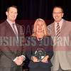 Tracy Lange of MetroPCS, center, is presented with her Women in Business Award from Brian Enzler, Market Executive, BMO Harris Bank, left, and Bill Hethcock of the Dallas Business Journal.