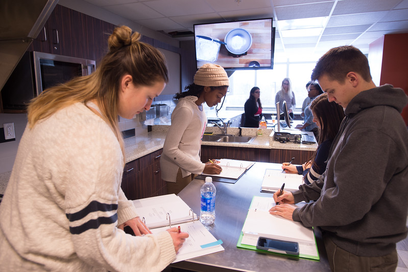 Students working in Professor Elizabeth Miller's Dietetics and Nutrition lab at SUNY Buffalo State.