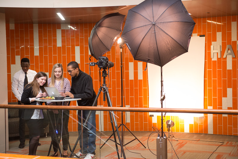 RITE Photography assistant, Nick Butler working with student clients at SUNY Buffalo State.