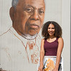 Buffalo State College alumnae Julia Bottoms-Douglas working on The Freedom Wall mural.
