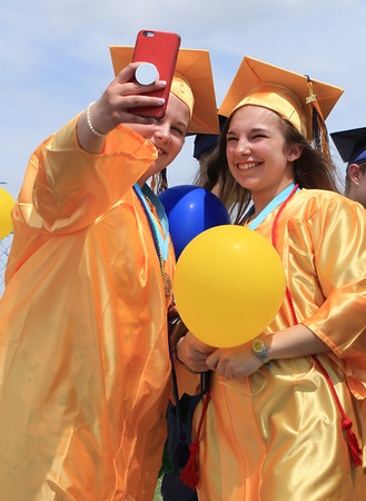 Roger Schneider | The Goshen News<br /> BreeAnn Cox snaps a selfie of herself and her friend Sheryl Brandenberger before they release balloons following the Fairfield graduation ceremony Sunday.