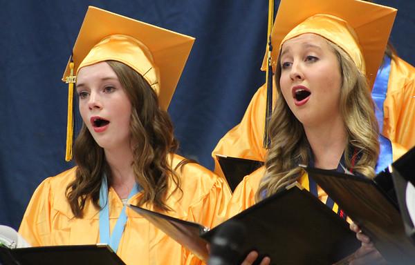 "Roger Schneider | The Goshen News<br /> Graduating Fairfield Jr-Sr. High School students sing ""River in Judea"" as part of the senior choir's performance during graduation ceremonies Sunday afternoon."