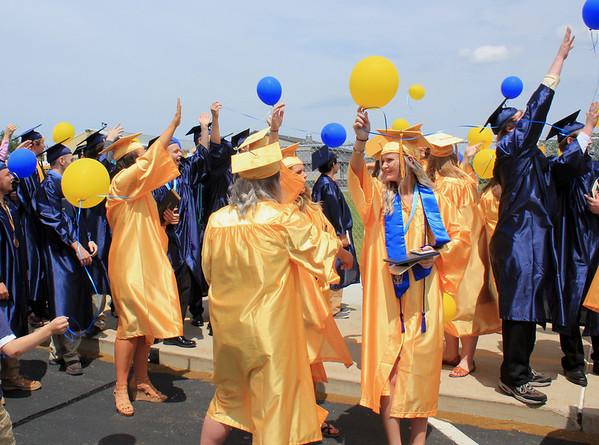 Roger Schneider | The Goshen News<br /> Fairfield graduates release balloons following their ceremony Sunday.