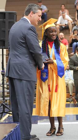 Roger Schneider   The Goshen News<br /> Winifred Sceniak receives her diploma from Superintendent Steve Thalheimer.