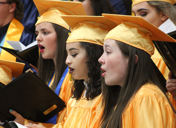 "Roger Schneider | The Goshen News<br /> Three graduating Fairfield Jr-Sr. High School students sing ""River in Judea"" as part of the senior choir's performance during graduation ceremonies Sunday afternoon."