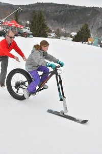 DSC_4635_Olivia Berkman, 10, of Albany, NY, tries out a fat bike  Her dad, Tom, is at left