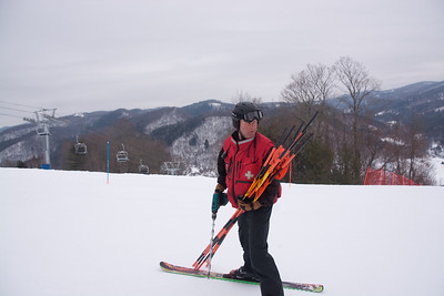 Joe Duane, Head of Ski Patrol, roping off the course