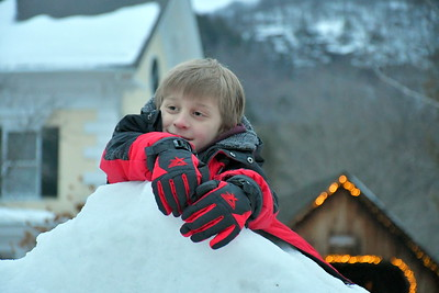 DSC_3708 elliot nelson,7, of New Hartford, CT,,climbing on big snow pile near campfire
