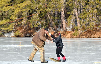 DSC_0362 richard bingham of bradford helps emma russell of quechee pull up a 29 inch norther pike,,,it was just a few minutes after the contest ended