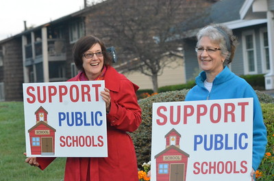 Leah McDonald - Oneida Daily Dispatch Public school supporters hold signs at the corner of Seneca Street and Route 5 on the first day of school on Thursday, Sept. 7, 2017.