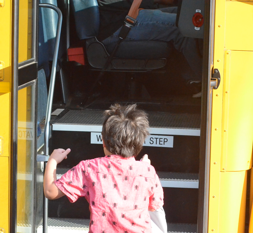 . Leah McDonald - Oneida Daily Dispatch Cecil McDonald gets on the bus for the first day of school on Thursday, Sept. 7, 2017.