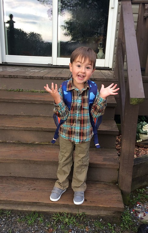 . Photo Courtesy Abigail Rogers Parker Koen of Morrisville waits for the bus on his first day of Pre-K, Thursday, Sept. 7, 2017.