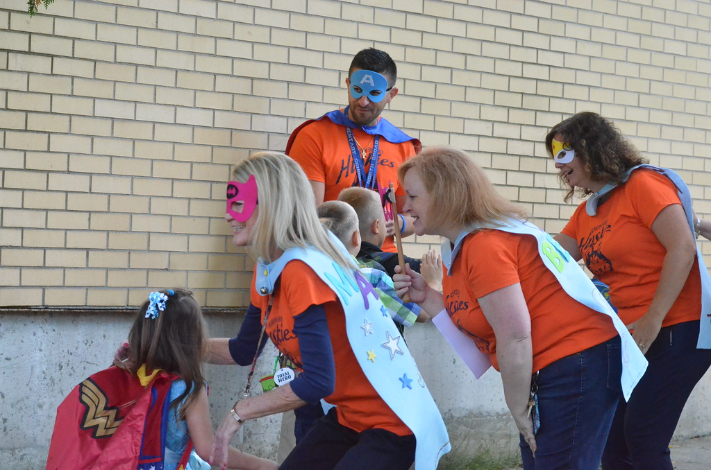 . Leah McDonald - Oneida Daily Dispatch Teachers and staff give students a superhero welcome at North Broad Street Elementary on the first day of school Thursday, Sept. 7, 2017.