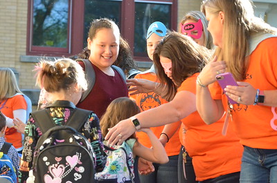 Leah McDonald - Oneida Daily Dispatch Teachers and staff give students a superhero welcome at North Broad Street Elementary on the first day of school Thursday, Sept. 7, 2017.