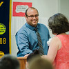 South Street Elementary Principal Johnathan Thompson presents Katie Labouno with an award during the annual Fitchburg Rotary Awards Dinner at FHS on Tuesday, May 16, 2017. SENTINEL & ENTERPRISE / Ashley Green