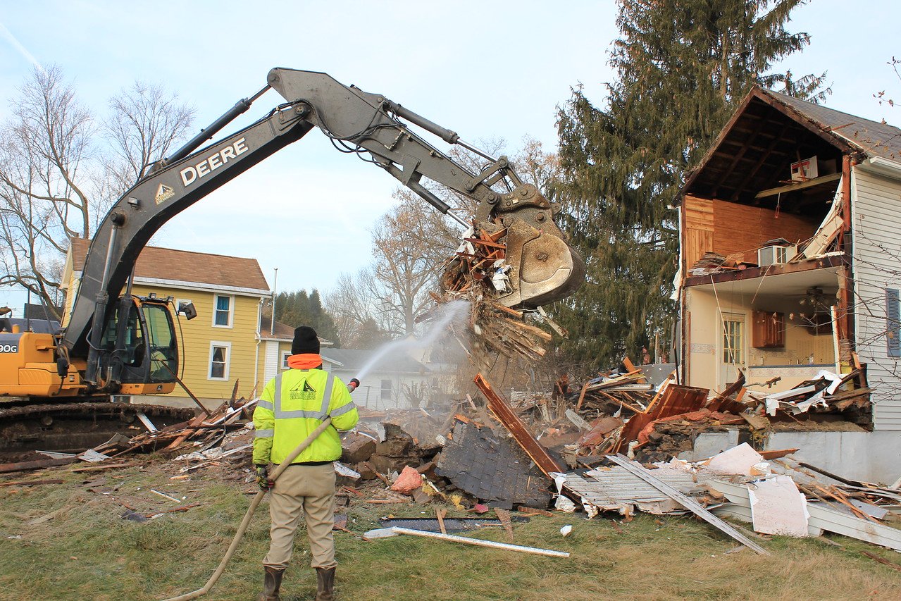 Charles Pritchard - Oneida Daily Dispatch Demolition crews from All Around Excavation tear down 529 Devereaux St. in the Oneida Flats on Tuesday, Nov. 28, 2017.
