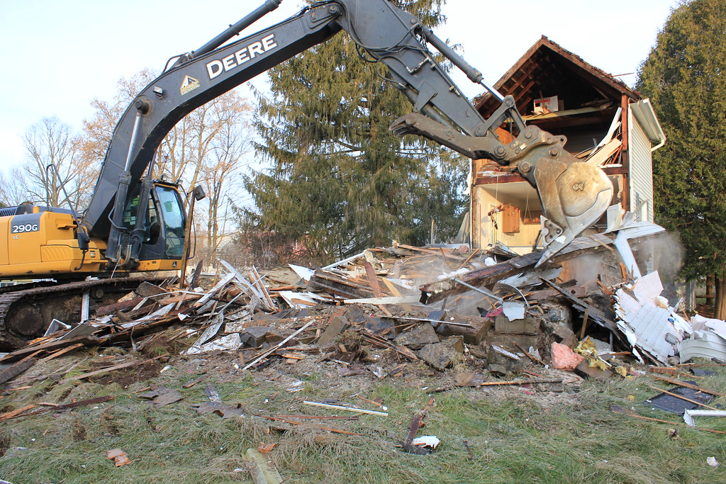 . Charles Pritchard - Oneida Daily Dispatch Demolition crews from All Around Excavation tear down 529 Devereaux St. in the Oneida Flats on Tuesday, Nov. 28, 2017.