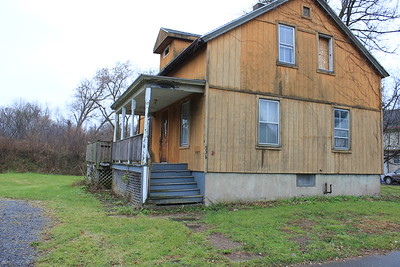 Charles Pritchard - Oneida Daily Dispatch Properties are ready for demolition on Devereaux Street in Oneida on Tuesday, Nov. 21, 2017. They are among more than 60 properties slated to be torn down in the Flats.