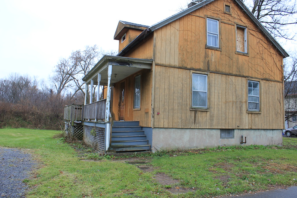 . Charles Pritchard - Oneida Daily Dispatch Properties are ready for demolition on Devereaux Street in Oneida on Tuesday, Nov. 21, 2017. They are among more than 60 properties slated to be torn down in the Flats.