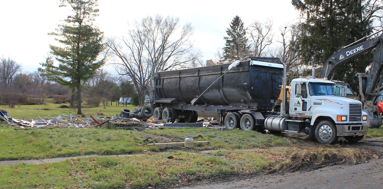 Charles Pritchard - Oneida Daily Dispatch Demolition crews bring down houses on Devereaux Street in Oneida on Tuesday, Monday, Nov. 27, 2017.