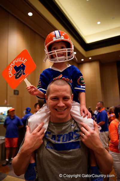 Florida Gators fans cheer on their team as the University of Florida Gators host a pep rally at the Omni Hotel the night before the Gators take on the Michigan Wolverines in the 2017 Advocare Classic. September 1st, 2017.  Gator Country photo by David Bowie.