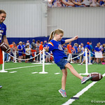 University of Florida Gators kicker Eddy Pineiro helps a young fan learn how to kick the ball as the Gators hold their annual fan day, signing autographs and mingling with the fans.  August 19th, 2017.  Gator Country photo by David Bowie.