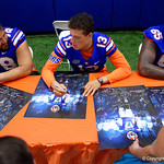 University of Florida Gators offensive lineman Ricardo Benalcazar,University of Florida Gators quarterback Feleipe Franks and University of Florida Gators offensive lineman Jawaan Taylor as the Gators hold their annual fan day, signing autographs and mingling with the fans.  August 19th, 2017.  Gator Country photo by David Bowie.
