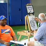 A young Florida Gators fan gets a portrait drawn of him as the Gators hold their annual fan day, signing autographs and mingling with the fans.  August 19th, 2017.  Gator Country photo by David Bowie.