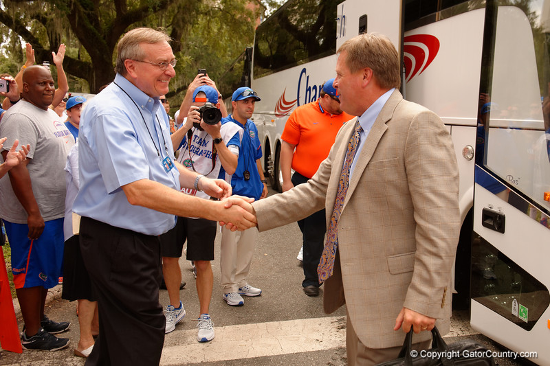 University of Florida Gators head coach Jim McElwain shakes hands with Florida President Kent Fuchs as the Gators walk into and across Steve Suprrier Field at  Ben Hill Griffin Stadium during Gator Walk for a date with SEC East rival, the Tennessee Volunteers.  September 16th, 2017.  Gator Country photo by David Bowie.