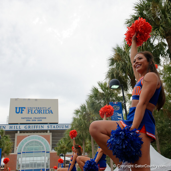 The Florida Gator Cheerleaders cheer on as the Gators walk into and across Steve Suprrier Field at  Ben Hill Griffin Stadium during Gator Walk for a date with SEC East rival, the Tennessee Volunteers.  September 16th, 2017.  Gator Country photo by David Bowie.