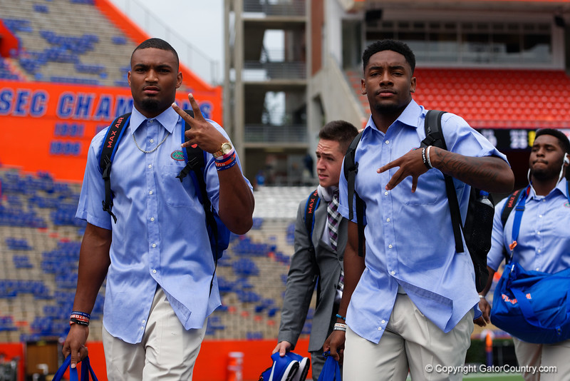 The Florida Gators football team walks into and across Steve Suprrier Field at  Ben Hill Griffin Stadium during Gator Walk for a date with SEC East rival, the Tennessee Volunteers.  September 16th, 2017.  Gator Country photo by David Bowie.