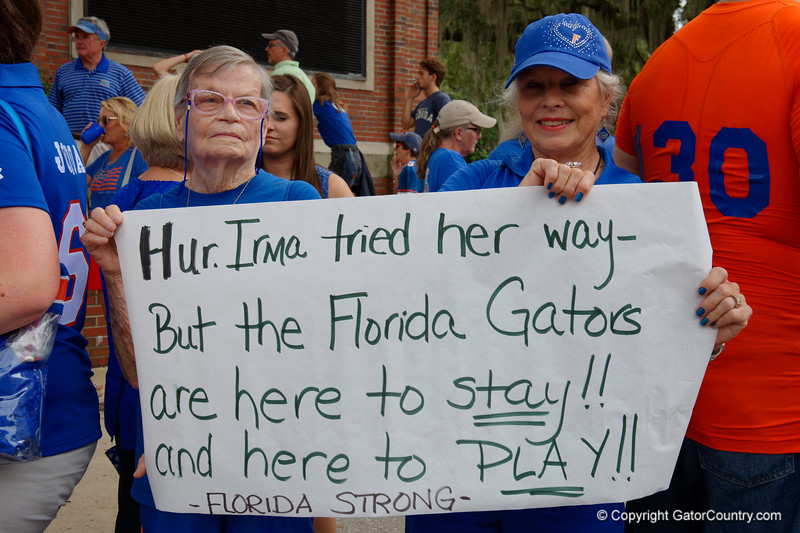 Florida Gators fans cheer on as the Gators walk into and across Steve Suprrier Field at  Ben Hill Griffin Stadium during Gator Walk for a date with SEC East rival, the Tennessee Volunteers.  September 16th, 2017.  Gator Country photo by David Bowie.