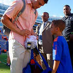 University of Florida Gators quarterback Feleipe Franks stops to sign a hat for a young fan as the Gators walk into and across Steve Suprrier Field at  Ben Hill Griffin Stadium during Gator Walk for a game against the Texas A&M Aggies.  October 14th, 2017.  Gator Country photo by David Bowie.