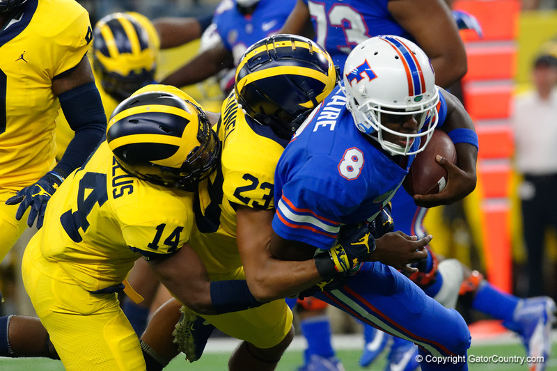 University of Florida Gators quarterback Malik Zaire is sacked during the second half of the 2017 Advocare Classic at AT&T Stadium in Dallas, Texas as the Florida Gators take on the Michigan Wolverines. September 2nd, 2017.  Gator Country photo by David Bowie.