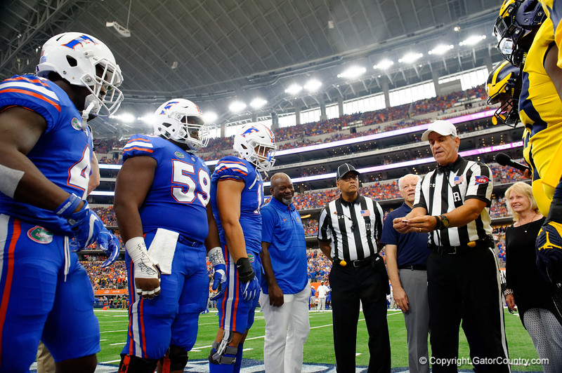 Former Florida Gator running back Emmitt Smith was named honorary captain of the Gators and walks to midfield with the Gator captains during pre-gamef of the 2017 Advocare Classic at AT&T Stadium in Dallas, Texas as the Florida Gators take on the Michigan Wolverines. September 2nd, 2017.  Gator Country photo by David Bowie.