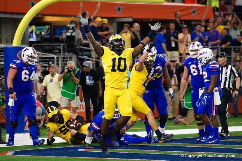 Michigan linebacker Devin Bush celebrates after Michigan scored on a fumble recovery in the endzone during the second half of the 2017 Advocare Classic at AT&T Stadium in Dallas, Texas as the Florida Gators take on the Michigan Wolverines. September 2nd, 2017.  Gator Country photo by David Bowie.