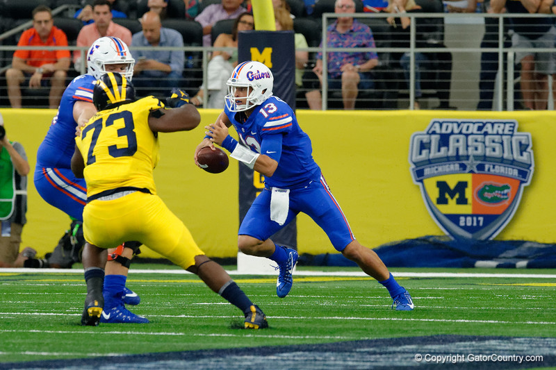 University of Florida Gators quarterback Feleipe Franks scrambling during the first half of the 2017 Advocare Classic at AT&T Stadium in Dallas, Texas as the Florida Gators take on the Michigan Wolverines. September 2nd, 2017.  Gator Country photo by David Bowie.