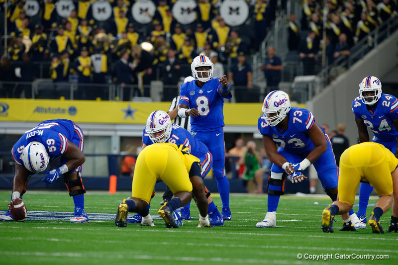 University of Florida Gators quarterback Malik Zaire calling out coverage at the line of scrimmage during the second half of the 2017 Advocare Classic at AT&T Stadium in Dallas, Texas as the Florida Gators take on the Michigan Wolverines. September 2nd, 2017.  Gator Country photo by David Bowie.