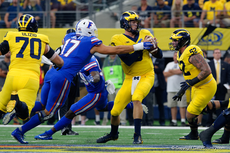 Michigan quarterback Wilton Speight sacked by University of Florida Gators defensive lineman Jordan Sherit during the first half of the 2017 Advocare Classic at AT&T Stadium in Dallas, Texas as the Florida Gators take on the Michigan Wolverines. September 2nd, 2017.  Gator Country photo by David Bowie.