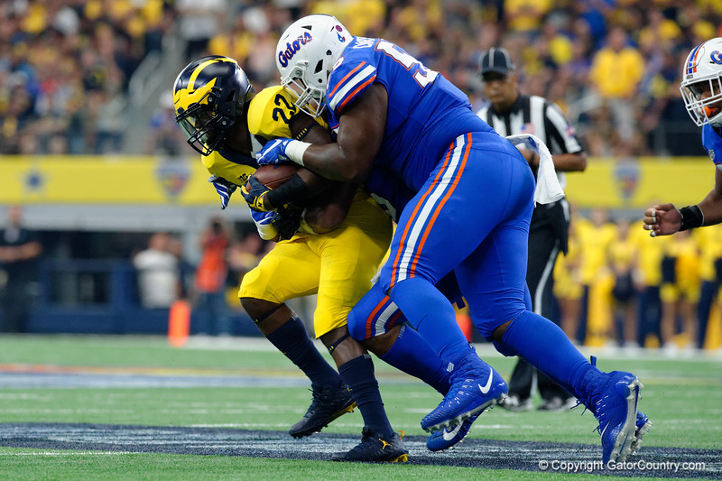 University of Florida Gators defensive lineman Kyree Campbell tackling Michigan running back Karan Higdon during the first half of the 2017 Advocare Classic at AT&T Stadium in Dallas, Texas as the Florida Gators take on the Michigan Wolverines. September 2nd, 2017.  Gator Country photo by David Bowie.
