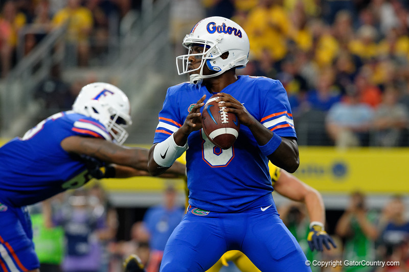 University of Florida Gators quarterback Malik Zaire scrambling during the second half of the 2017 Advocare Classic at AT&T Stadium in Dallas, Texas as the Florida Gators take on the Michigan Wolverines. September 2nd, 2017.  Gator Country photo by David Bowie.
