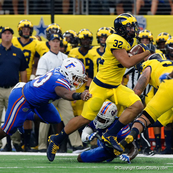 Michigan running back Ty Isaac rushing during the first half of the 2017 Advocare Classic at AT&T Stadium in Dallas, Texas as the Florida Gators take on the Michigan Wolverines. September 2nd, 2017.  Gator Country photo by David Bowie.