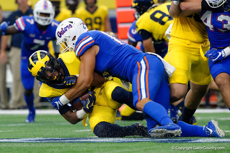 University of Florida Gators defensive lineman Jordan Sherit tackling Michigan running back Chris Evans during the first half of the 2017 Advocare Classic at AT&T Stadium in Dallas, Texas as the Florida Gators take on the Michigan Wolverines. September 2nd, 2017.  Gator Country photo by David Bowie.
